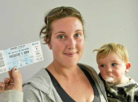 BOXING BOUND:  Katelyn Fox pictured with son Ray Frost is excited to win tickets to the Manny Pacquiao vs Jeff Horn boxing match at Suncorp Stadium. Wednesday, 28th Jun, 2017.