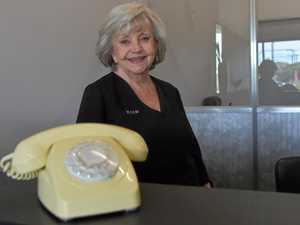 Director of Rex Silver Insurance Brokers Pty Ltd Thelma Silver and the 1983 analogue telephone used to call Ergon Energy during the region's power outage.