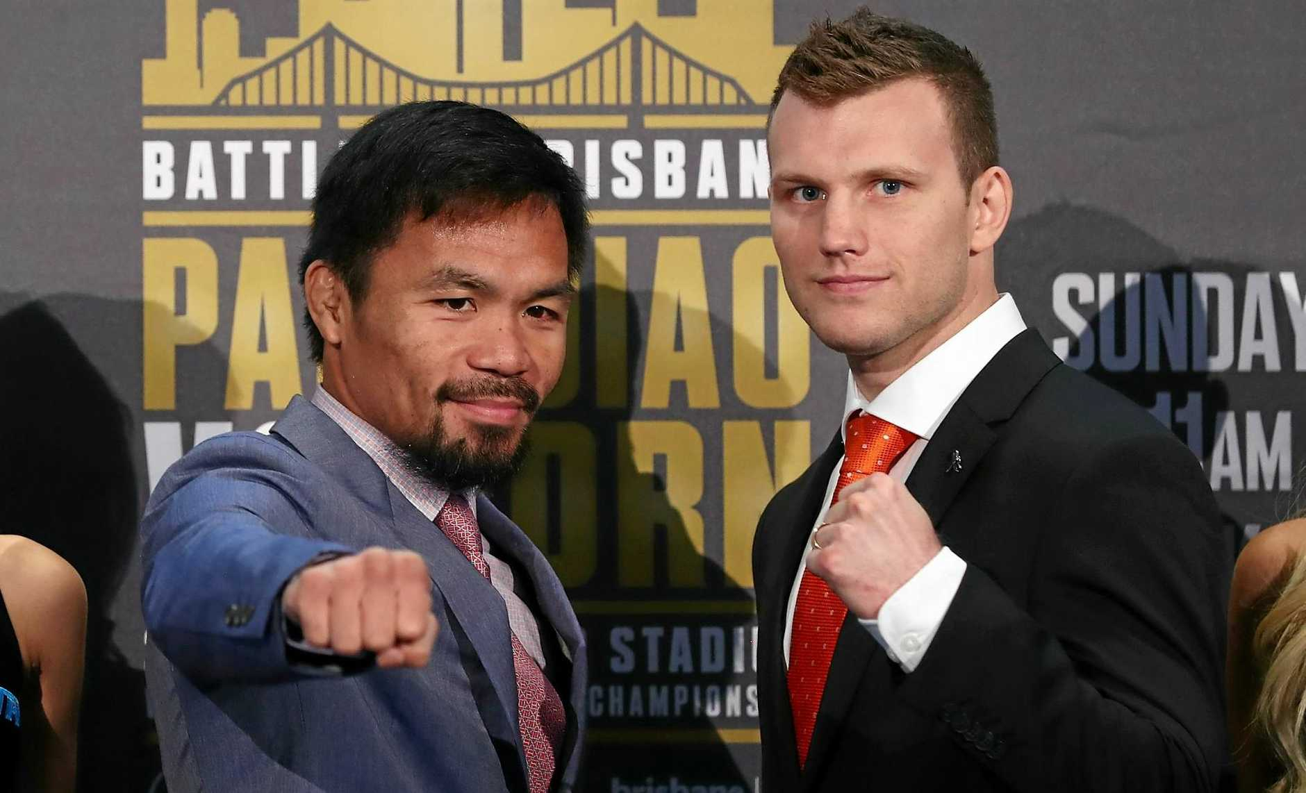 Manny Pacquiao (left) and Jeff Horn face off after the official press conference for tomorrow's WBO World Welterweight Championship at Suncorp Stadium.