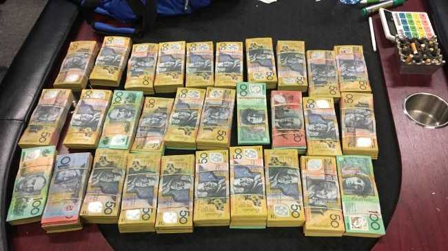 Bundles of cash seized by officers during the heavily armed raids.