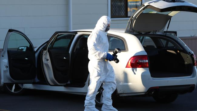 Forensic investigator examines a car linked to the shooting murder of Ace Hall in Steep Street, Tweed Heads.