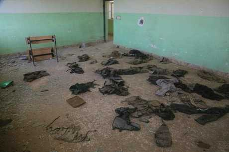 This picture taken earlier this month shows clothes laid on the ground of a classroom inside a school in the village of Kocho , south of the Yazidi hub of Sinjar in northern Iraq. In 2014, ISIS militants perpetrated the Sinjar massacre, killing 2,000 Yazidi men and taking Yazidi women into slavery, leading to a mass exodus of Yazidi residents. (AAP Image/NEWZULU/Ali Salim).