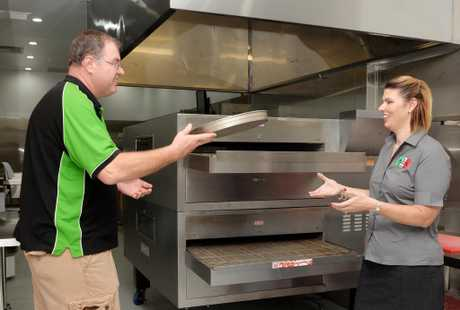 Mark and Amanda Webber from Ma's Pizza Kitchen with the pizza oven, a Blodgett 3870, which was sourced so their pizzas would be exactly the same as their other store.Photo Tony Martin / Daily Mercury
