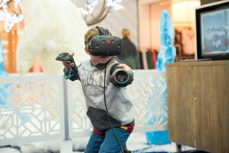 Grand Central Shopping Centre school holiday activities. Caleb Webber having some fun using Snow Slingers Virtual Reality.