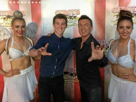 RISING STAR: Ipswich magician Jeffro Bennett has run away to Michael Boyd's (right) Circus of Illusion on the Gold Coast.