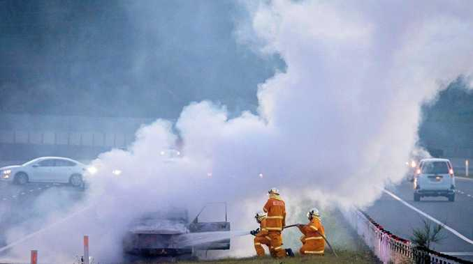 Rural Fire Service crews respond to a car fire on the Pacific Highway at Sandy Beach last night.