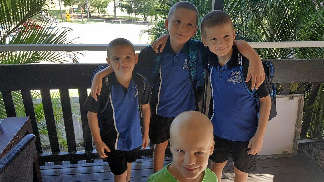 Brothers Khynan, Dylan, Arlen Reid (back) and Brandon Pickering (front centre) in One Mile State School uniform.