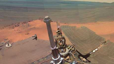 Composite image of the Mars Opportunity rover overlooking a canyon on Mars. Picture: NASA.