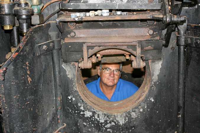 FULL STEAM AHEAD: Ray Gamble at work inside the steam locomotive's firebox.
