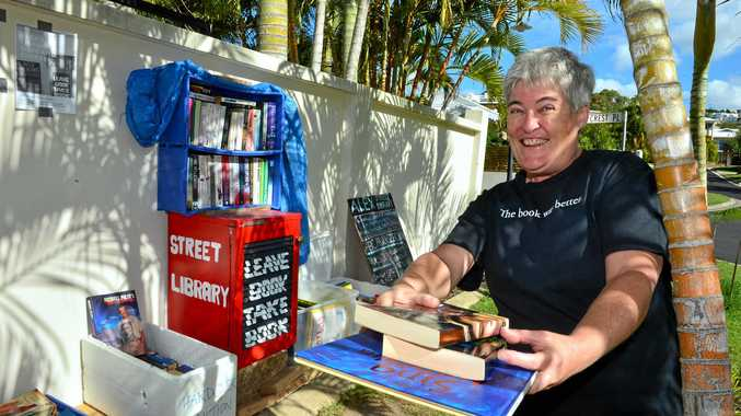 BOOK WORM: Sue Perry started the Sunshine Coast's first street library out the front of her Alex Headland home.