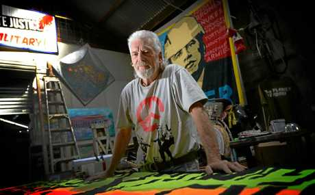 PPEACE NOT WAR: Peace activist Graeme Dunstan works on a banner for the protests he is holding in Rockhampton .