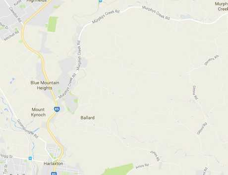 A section of the New England Hwy is closed after a fallen tree has brought down powerlines.
