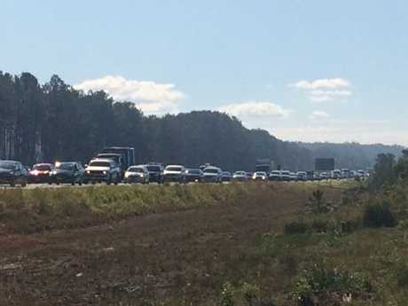 An army supply truck has flipped on the Bruce Hwy, leaving up to 12km of traffic chaos.