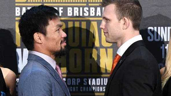 Manny Pacquiao of the Philippines (left) faces off with Australia's Jeff Horn following the official press conference for their WBO welterweight championship fight at Suncorp Stadium in Brisbane, Wednesday, June 28, 2017.