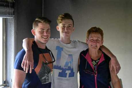 FAMILY UNIT: Gabe, James and Cam at the home that was destroyed in a fire.