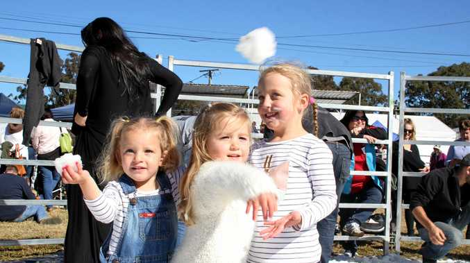 Chloe Staley and Greta Stibbard aim for their parents while Imogen Staley watches on at Snowflakes in Stanthorpe on Saturday, July 1.