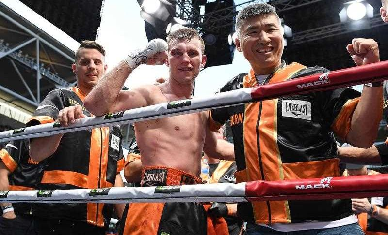 Jeff Horn of Australia (centre) celebrates his win against Manny Pacquiao of the Philippines during the WBO World Welterweight Title fight at Suncorp Stadium in Brisbane, Sunday, July 2, 2017.