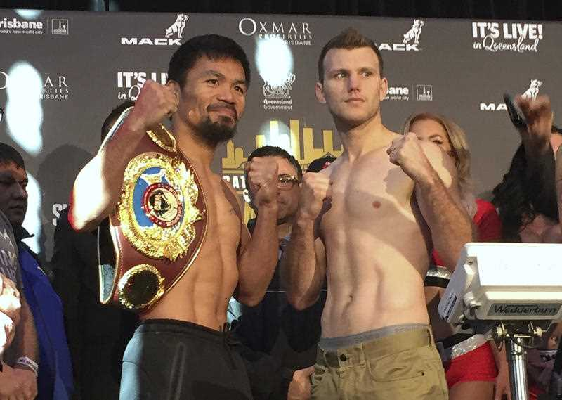 Manny Pacquiao, left, and Jeff Horn pose for a photo after weighing in, Tuesday, July 1, 2017, in Brisbane, Australia. Pacquiao, is putting his WBO welterweight world title on the line Sunday, July 2, against the 29-year-old Horn.