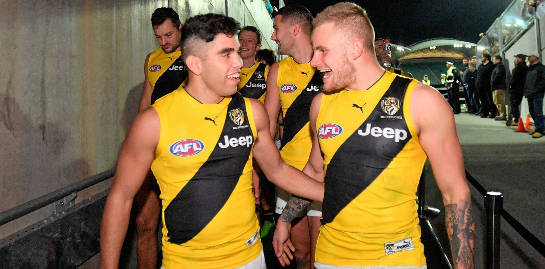 Tigers rookie Tyson Stengle (left) celebrates after making his debut in the Round 15 win over Port Adelaide at Adelaide Oval on Saturday.
