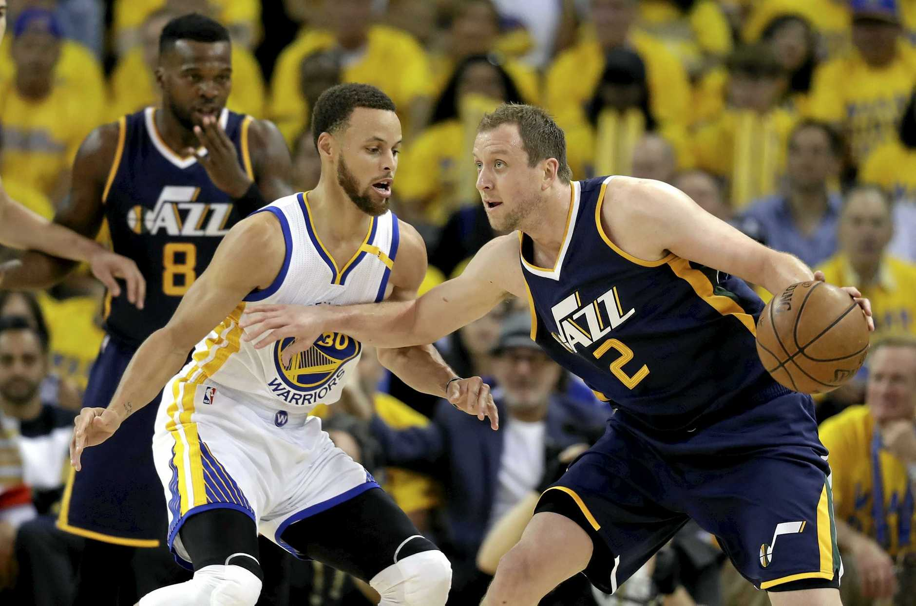 Utah Jazz's Joe Ingles (2) takes on Golden State Warriors' Stephen Curry during the NBA playoff series.
