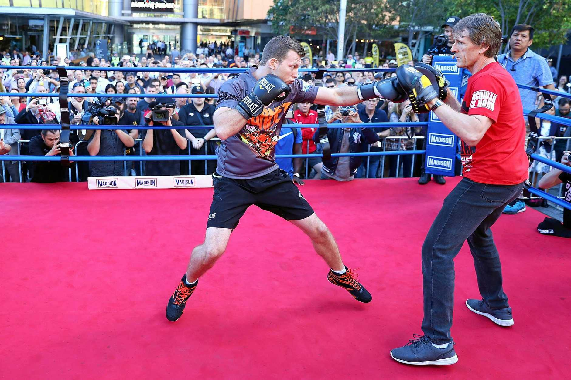 CHAMPION IN MAKING: Jeff Horn hits the pads with trainer Glenn Rushton.