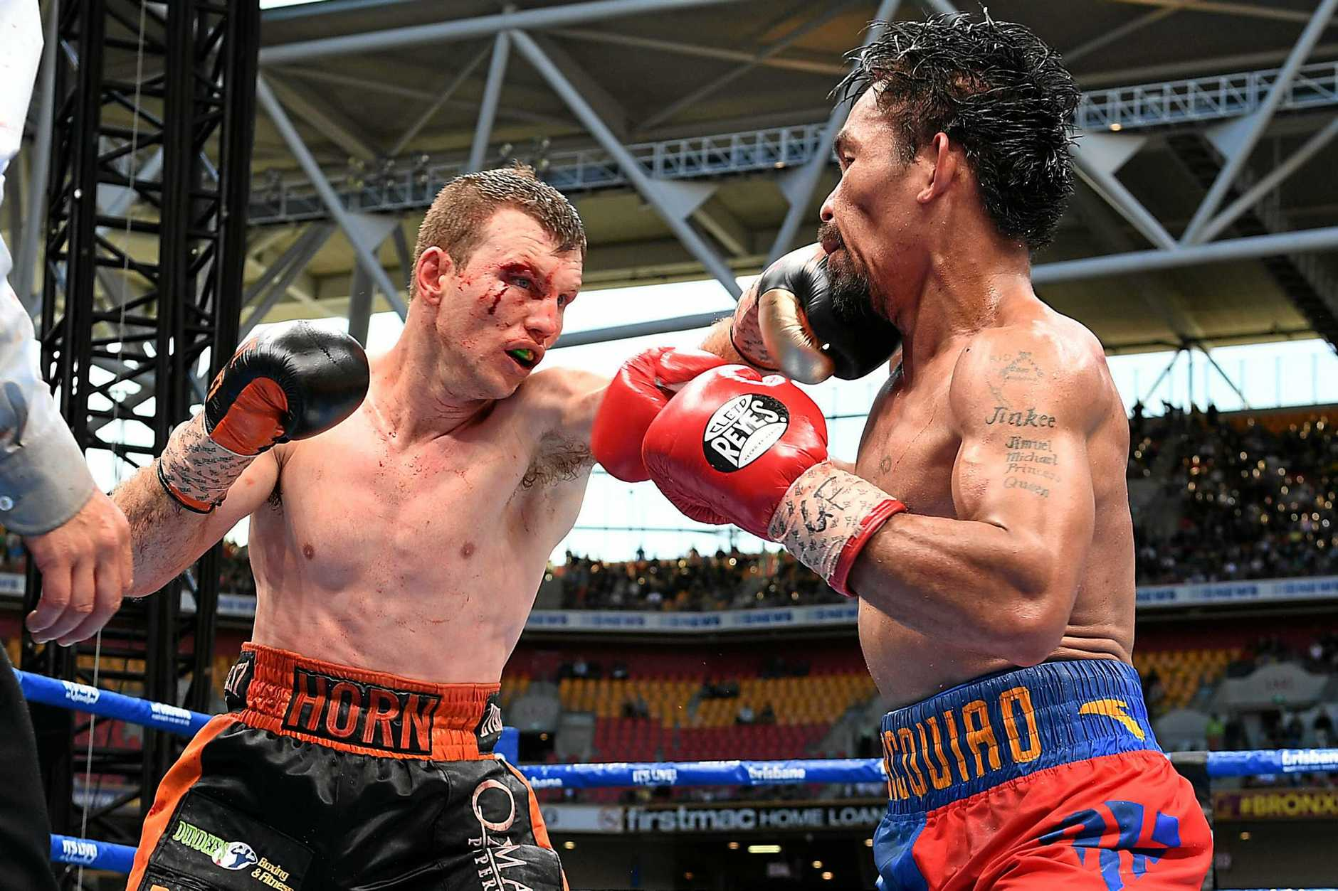 Jeff Horn (left) lands a blow against Manny Pacquiao during their WBO world welterweight title fight.