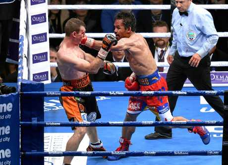 Manny Pacquiao (right) takes the fight to Jeff Horn.