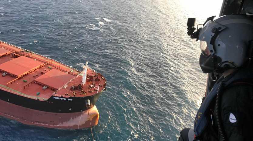 The RACQ CQ Rescue chopper approaches bulk carrier Night Kiss.