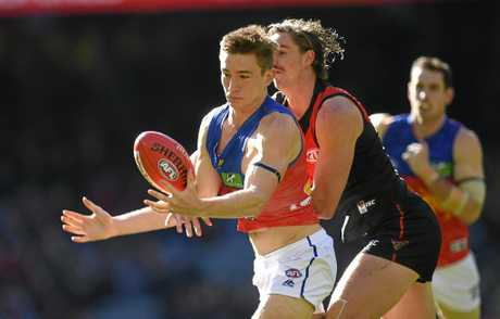Lions youngster Harris Andrews (left) beats Essendon rival Joe Daniher to the ball.