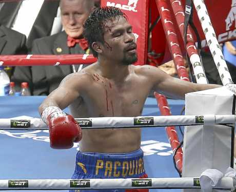 Manny Pacquiao of the Philippines waves to his supporters after his loss to Jeff Horn of Australia, during their WBO World Welterweight title fight in Brisbane, Australia, Sunday, July 2, 2017. (AP Photo/Tertius Pickard)
