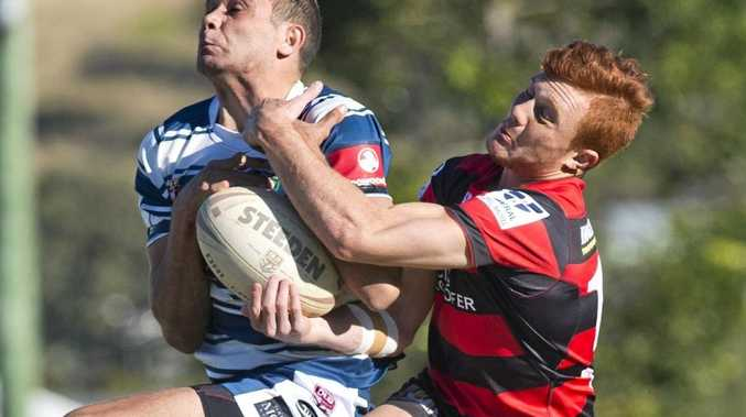 CONTEST: Brothers' Sam Betros takes the ball under pressure from Valleys young gun Travis Turnbull at Glenholme Park.
