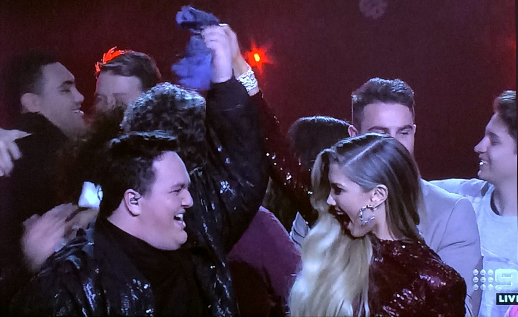 Queensland's Judah Kelly celebrates his Voice win with mentor Delta Goodrem.