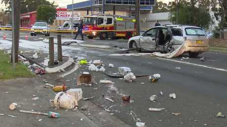 Paint and wreckage is strewn across the road. Picture: Top Notch Video