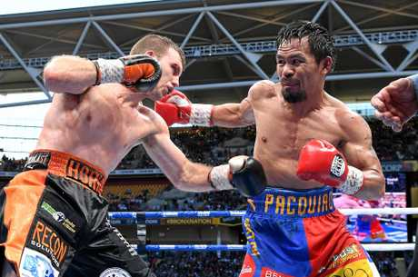 Jeff Horn (left) and Manny Pacquiao connect with solid hits during their WBO World Welterweight title fight.