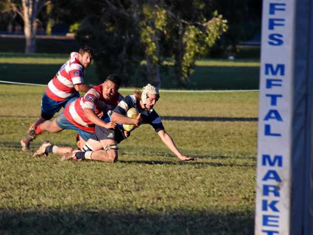 SURGING ON: SCU Marlins flanker Mackenzie Smyth pushes for the try line in the SCU v Wauchope Thunder clash.