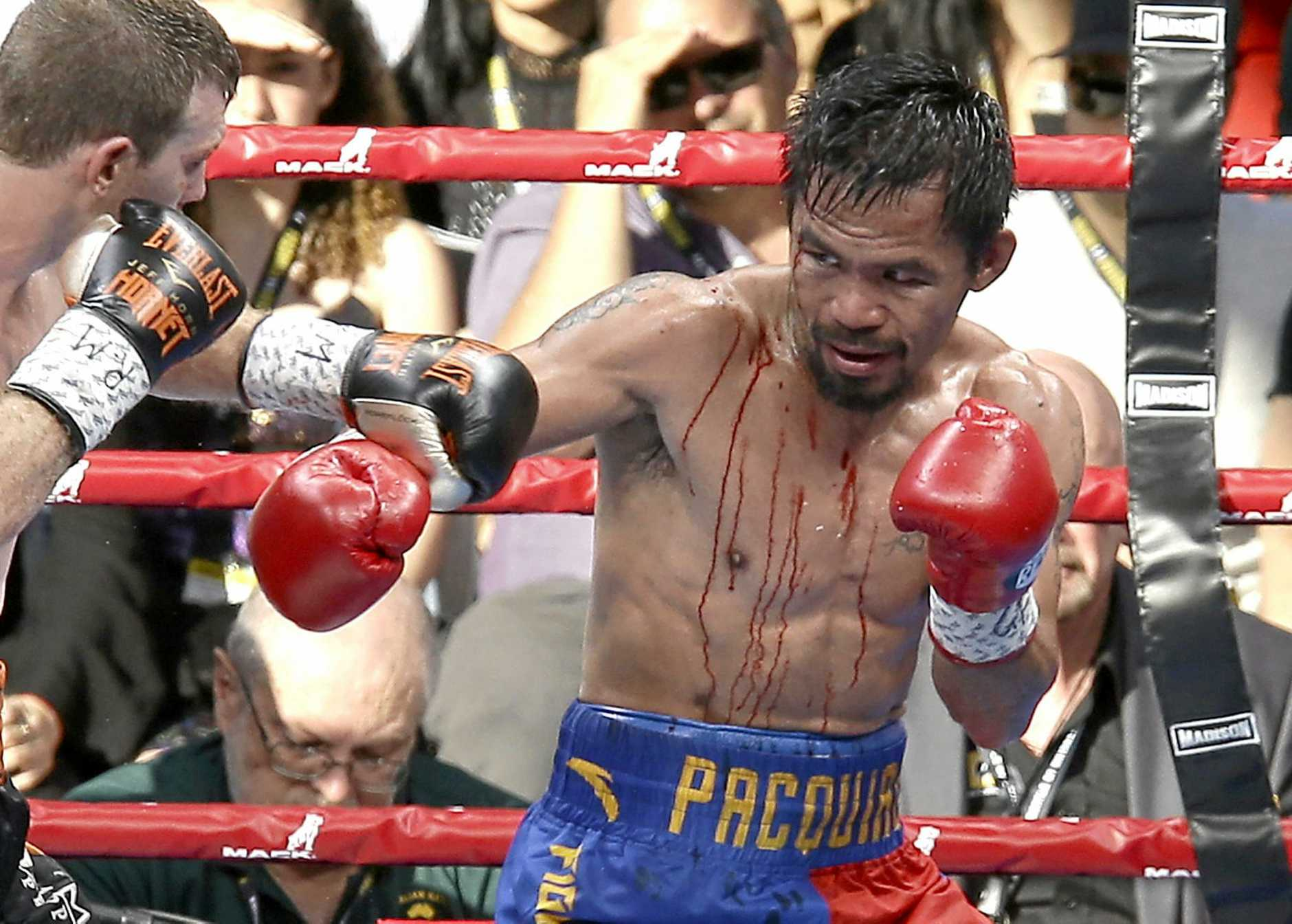 BROKEN MAN: Manny Pacquiao was bloodied and bruised by a determied Jeff Horn during their WBO World welterweight title bout in Brisbane.