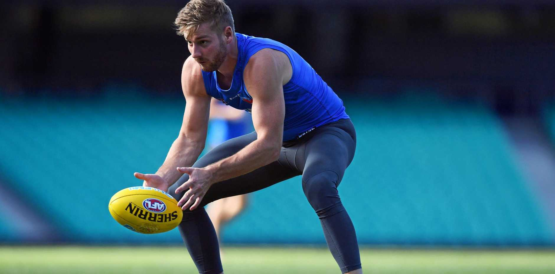 BACK AGAIN: Sydney Swans player Alex Johnson ran out for the team's NEAFL Canberra team at the weekend his first game in 1736 days after a fifth knee reconstruction.