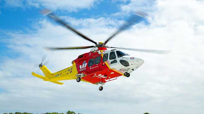 A man has been hurt after falling onto rocks and into the ocean.