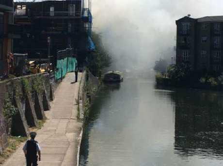 Smoke billows across Regents Canal in Bethnal Green, East London.