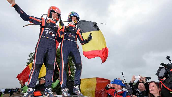 Thierry Neuville (right) and co-driver Nicolas Gilsoul celebrate their hard-fought victory on Rally Poland.