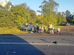 Car flipped in crash on Pacific Highway