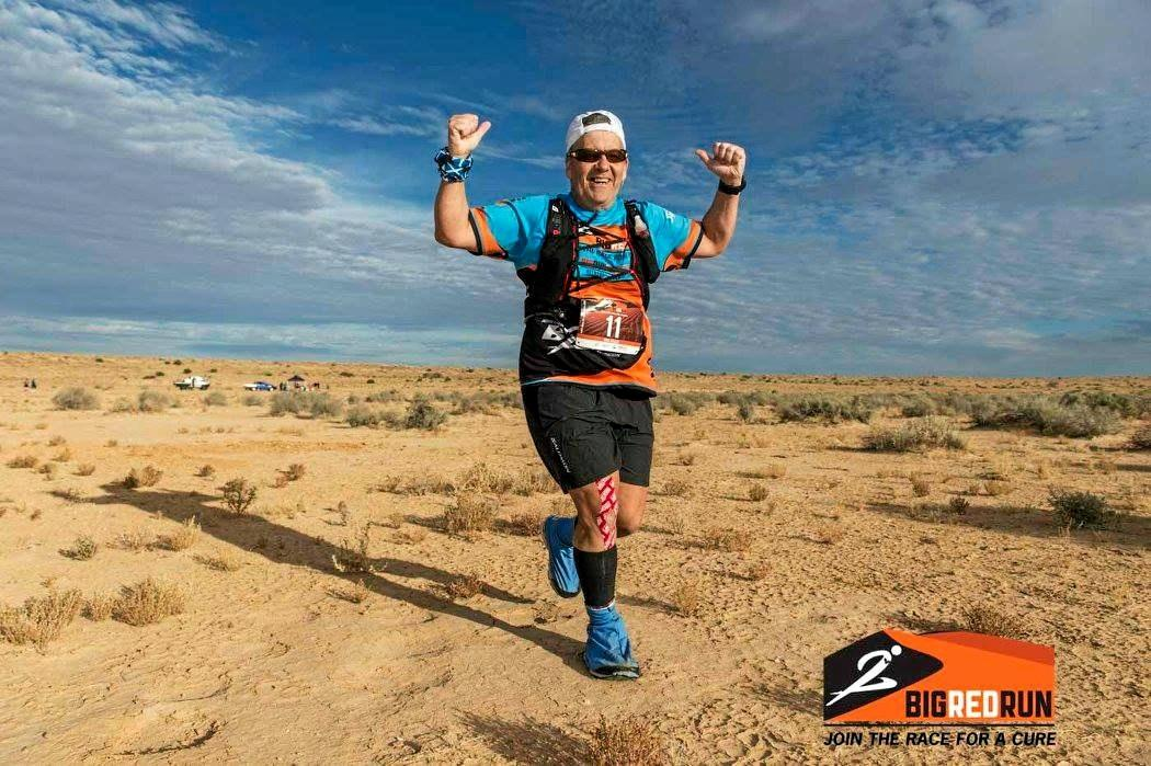 Neil Collie runs through the Simpson Desert.