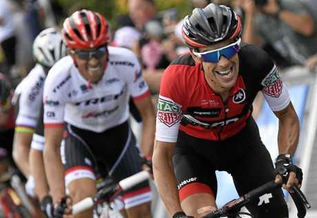 BMC Racing Team rider Richie Porte (right), of Australia, alongside Trek Segafredo team rider Alberto Contador, of Spain.