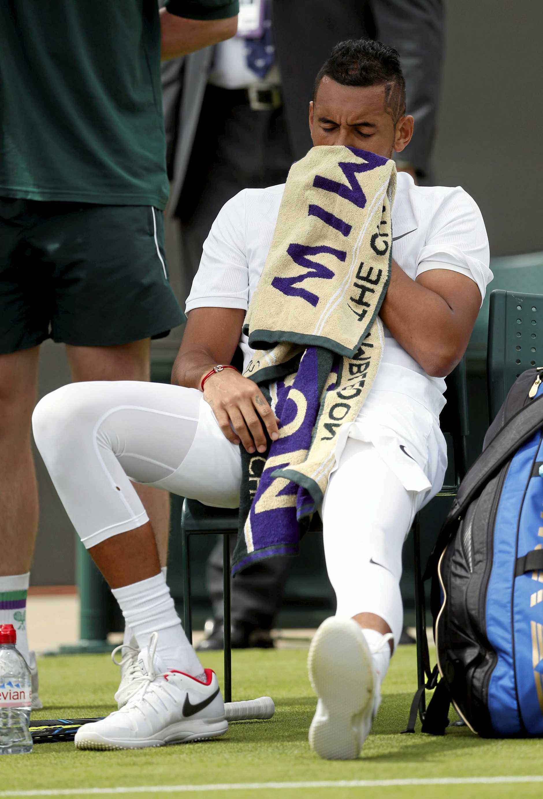 Australia's Nick Kyrgios wipes his face during change of ends in his Men's Singles Match against Pierre-Hugues Herbert of France, on the opening day at the Wimbledon Tennis Championships in London Monday, July 3, 2017. (AP Photo/Kirsty Wigglesworth)