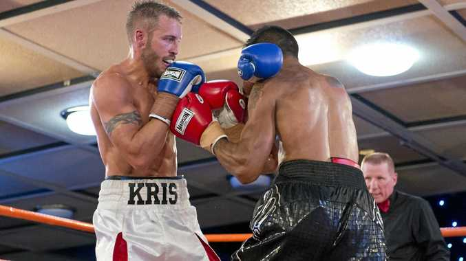 Toowoomba's Kris George (left) and Cameron Hammond fight for the Commonwealth welterweight title in Toowoomba last November.