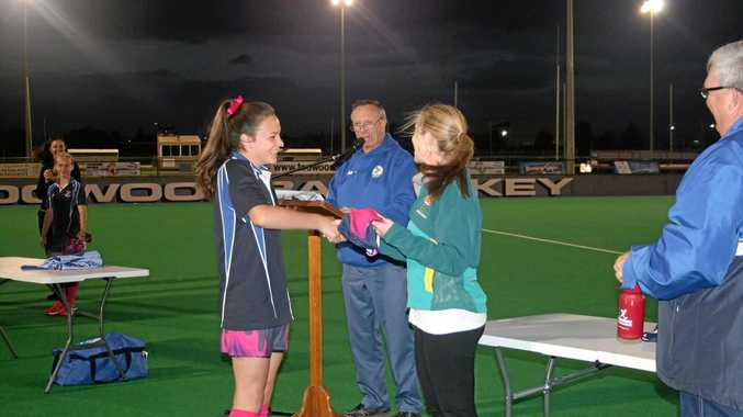 BIG MOMENT: Toowoomba representative Caleiah Budd presented with her playing strip by former Hockeyroo Karen Smith.