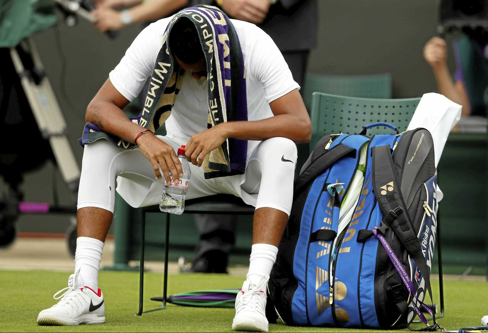 DOWN AND OUT: Australia's Nick Kyrgios is suffering during his first round match against Pierre-Hugues Herbert at Wimbledon.