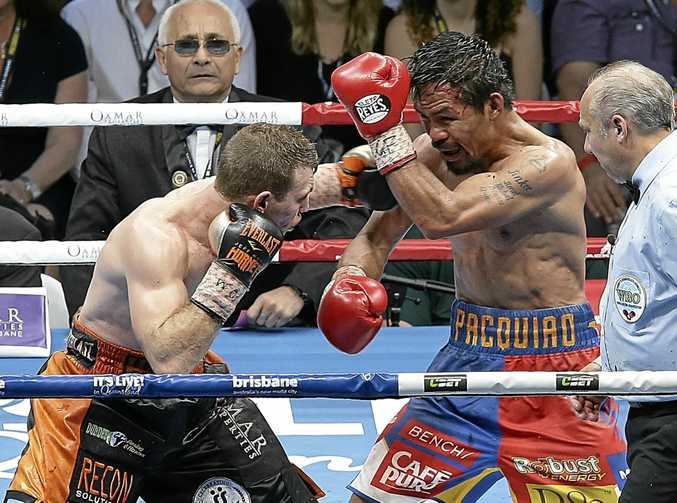 TAKE THE REMATCH: Manny Pacquiao (centre) has been told to fight Jeff Horn again, but demand referee Marl Nelson (right) and the three judges be replaced.