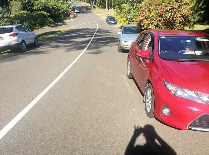 Philip Coates parked on Crescent Rd in Eumundi on a busy Saturday market day, and was given a parking fine. His red car is pictured on the right.
