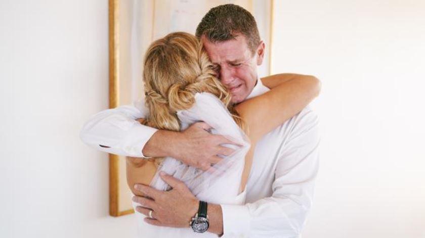 Mike Baird breaks down seeing his daughter in her wedding dress.
